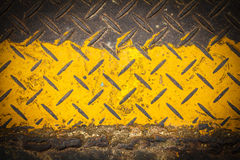 Dark steel floor plate paint with yellow pattern Royalty Free Stock Photography