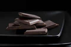 Dark still-life with detail of chocolate stock photos
