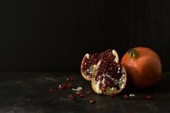 Dark Still Life of Pomegranate Fruit Stock Images
