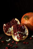 Dark Still Life of Pomegranate Fruit Royalty Free Stock Photos