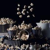 Dark still life with popcorn Stock Photography