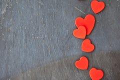 Dark stone background with hearts Stock Photos