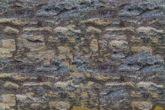Dark stone background of limestone natural background wall of an old building Stock Photo