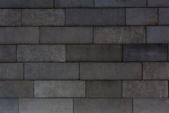 Dark stone brick background close up Stock Images