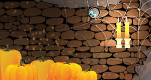 Dark stone dungeon. Halloween background. Halloween pumpkins in a stone dungeon with cobweb, spider and burning candles Stock Images