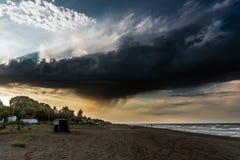 Dark storm cloud over the beach stock photo