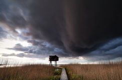 Dark storm cloud over observation tower Stock Photos