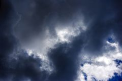 Dark storm cloud with sun on the sky. Dark storm cloud with sun on the blue sky on summer day stock photo