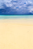 Dark storm clouds above a deserted beach Stock Image