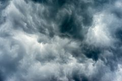 Dark storm clouds. Beautiful dark ominous grey storm clouds. Dramatic sky, like apocalypse royalty free stock images