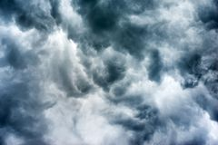 Dark storm clouds. Beautiful dark ominous grey storm clouds. Dramatic sky, like apocalypse royalty free stock photos
