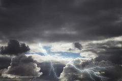 Dark storm rain clouds with lightning. Gathering dark storm clouds with thunder and lightning in the skies Royalty Free Stock Images