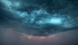 Dark storm clouds. And lightning strike are in sky Royalty Free Stock Images