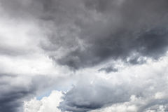 Dark storm clouds. Dark ominous grey storm clouds - dramatic sky royalty free stock image
