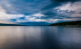 Dark storm clouds over Cayuga Lake, in Ithaca, New York. stock images