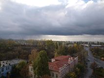 Dark storm clouds over the city, cloudy weather royalty free stock photos