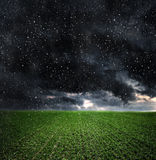 Dark storm clouds over meadow Stock Image