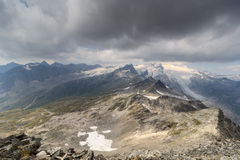 Dark storm clouds over mountain Grossvenediger and glacier, Hohe Tauern Alps, Austria. Dark storm clouds over mountain Grossvenediger and glacier in Hohe Tauern Royalty Free Stock Photography