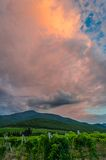 Dark storm clouds over the mountains. And vineyards Royalty Free Stock Images