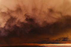 Dark storm clouds over the sea. Royalty Free Stock Photography