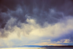 Dark storm clouds over the sea. Royalty Free Stock Images