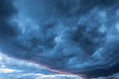 Dark storm clouds. Dark storm clouds before the rain at sunset stock photo
