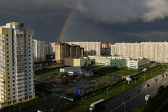 Dark storm clouds and rainbow over city. Tyumen.  royalty free stock photos
