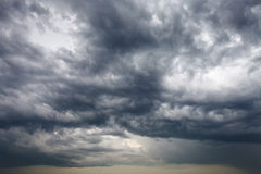 Dark storm clouds in the spring sky Stock Photos