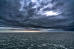 Dark stormy cloud above the sea, dark tone nature abstract Royalty Free Stock Photography