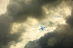 Dark stormy clouds covering the sky as nature background. Royalty Free Stock Image