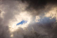 Dark stormy clouds covering the sky as nature background. Stock Images