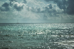 Dark stormy clouds and lighted sea Royalty Free Stock Photo
