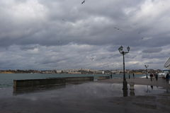 Dark stormy clouds and lighted sea. Sevastopol Stock Photo