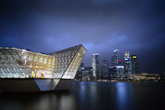 Dark stormy clouds on Louis Vuitton Store at MBS royalty free stock images