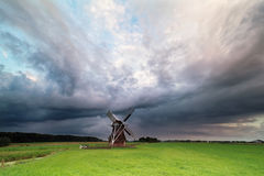 Dark stormy clouds over windmill Royalty Free Stock Photography