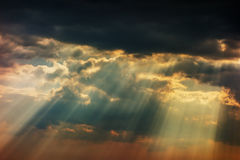 Dark stormy clouds. Stormy sky with a dramatic sunrays between the clouds on spring evening in Greece stock images