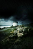 Dark stormy clouds and strong wind by the ocean. In Land's End, UK royalty free stock images