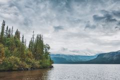 Dark stormy clouds under lake. Dramatic landscape. Dark stormy clouds under lake and forest. Dramatic landscape royalty free stock photo