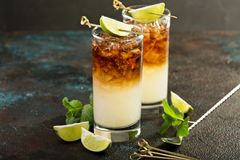 Dark and stormy cocktail. With ginger ale and rum stock photo