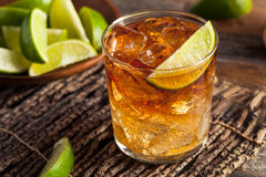 Dark and Stormy Rum Cocktail. With Lime and Ginger Beer royalty free stock images