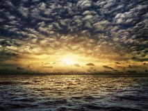 Dark stormy sea with a dramatic cloudy sky Stock Image