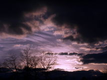 Dark Stormy Skies. A sunset with dark cloudly skies royalty free stock photo