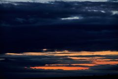 Dark stormy sky with clouds at night royalty free stock photo