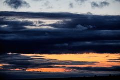 Dark stormy sky with clouds at night royalty free stock photography