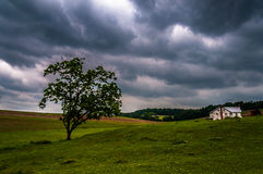 Dark stormy sky over trees and a house in York County Royalty Free Stock Photo