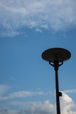Dark street light isolated with cloudy blue sky royalty free stock photography