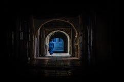 Dark street in medina of Essaouira. Dark corridor in center of medina, Essaouira Stock Photo