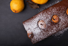 Dark style photo of chocolate cake with pears Royalty Free Stock Images