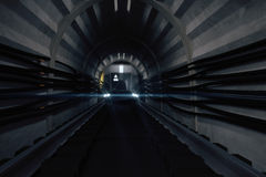 Dark subway tunnel with train Royalty Free Stock Image