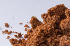Dark sugar and unrefined sugar cane. Close-up Royalty Free Stock Images